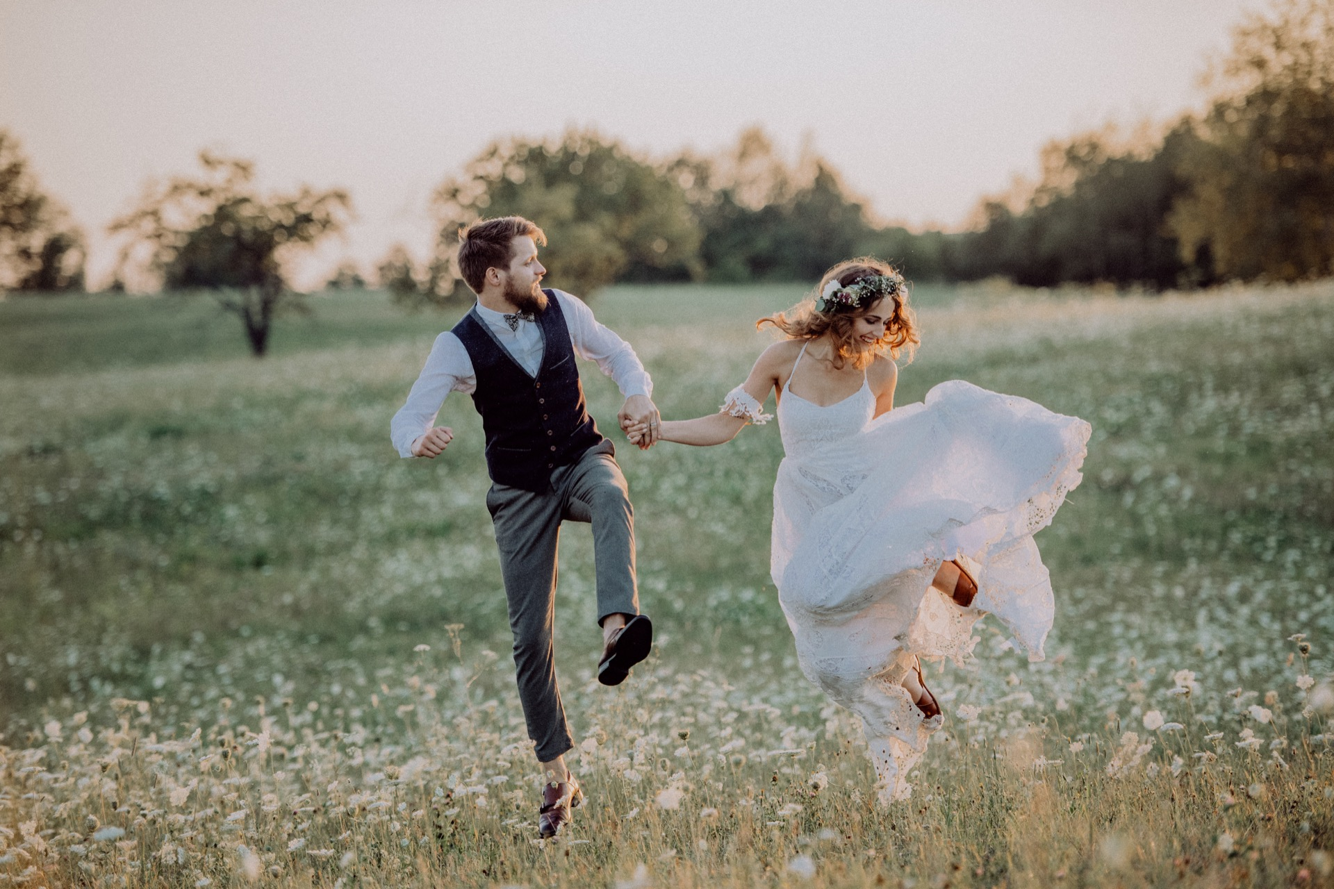 beautiful-bride-and-groom-at-sunset-in-green-natur-PS3WDVS.jpg