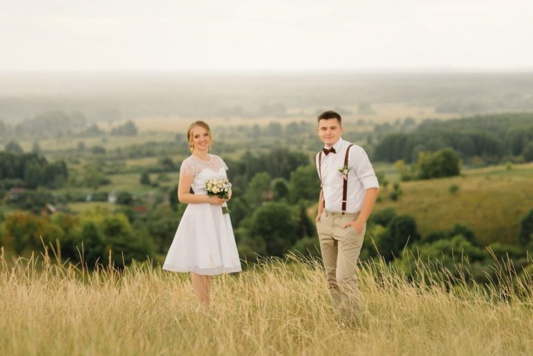 optimize- loving-couple-posing-against-beautiful-view-wedding-day-bride-groom