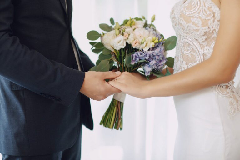 optimize- young-beautiful-bride-is-standing-with-her-husband