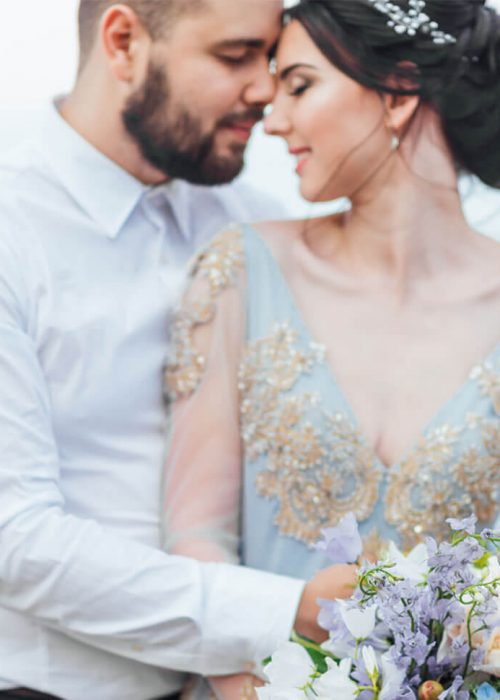 same-couple-with-a-bride-in-a-blue-dress-walk-RBBL2G9.jpg